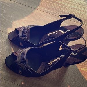 Nina black sandals, genuine leather sole.